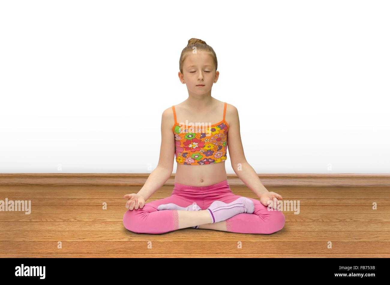 girl practices yoga - Stock Image