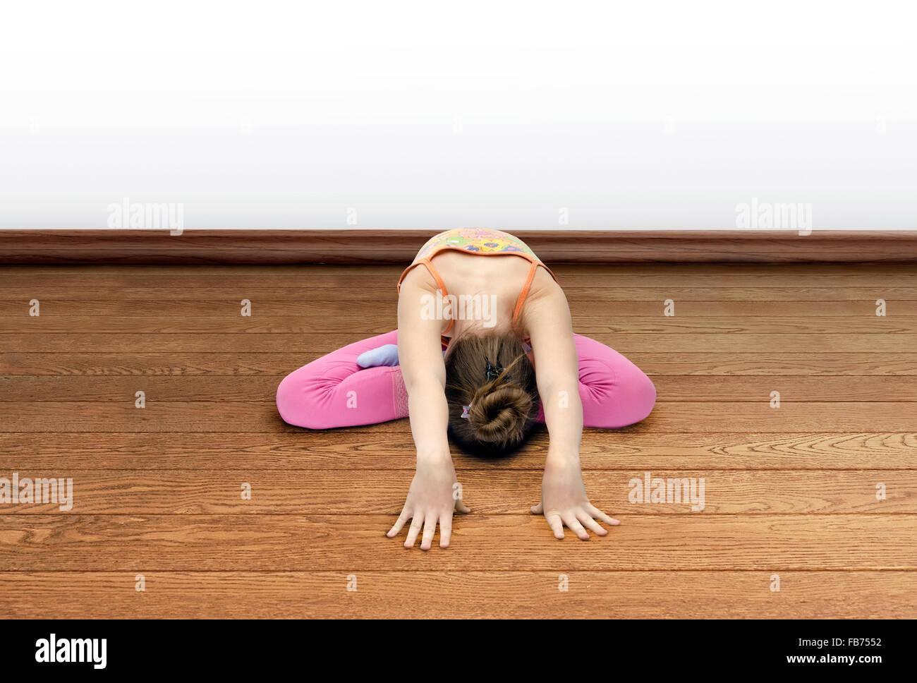 little girl practices yoga - Stock Image