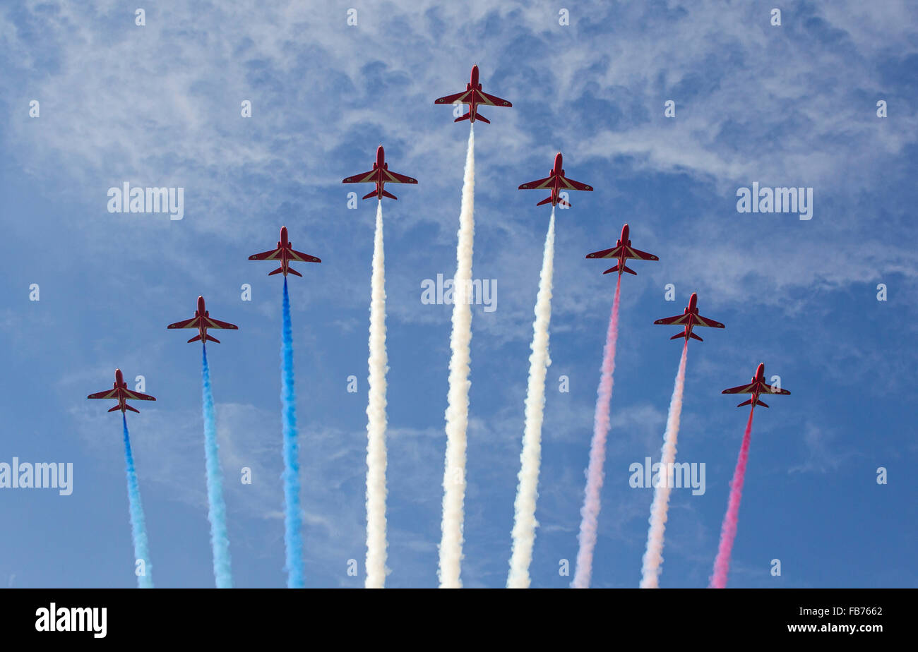 Red Arrows against blue sky - Stock Image