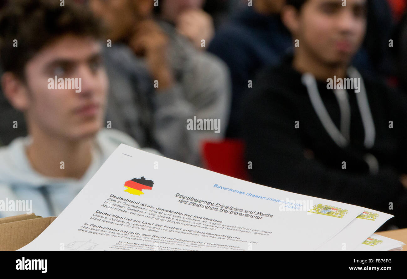 A document reads 'Fundamental principles and values ??of the German legal system' during the launch of the - Stock Image