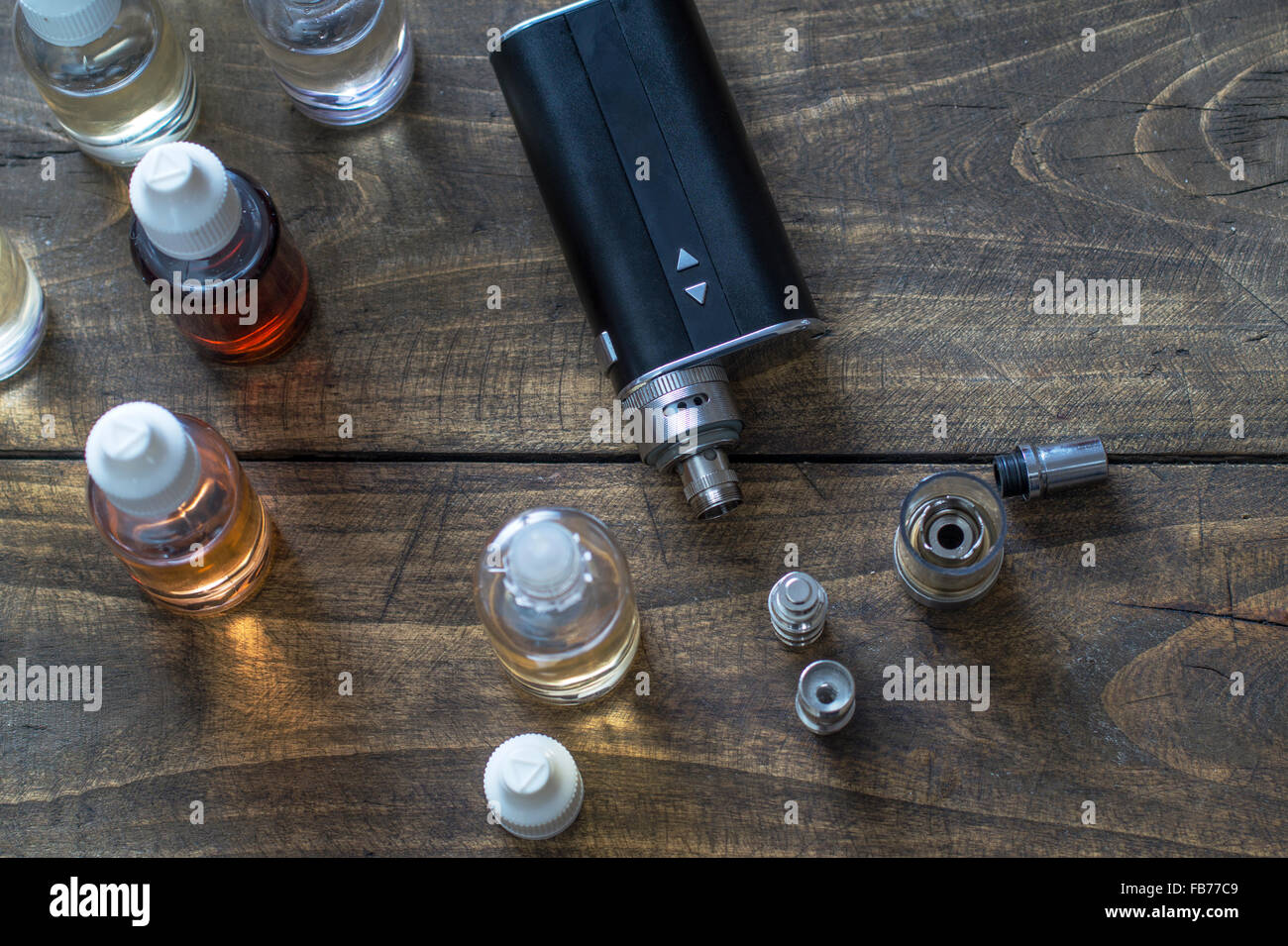 e-cigarettes with lots of different re-fill bottles, from above - Stock Image