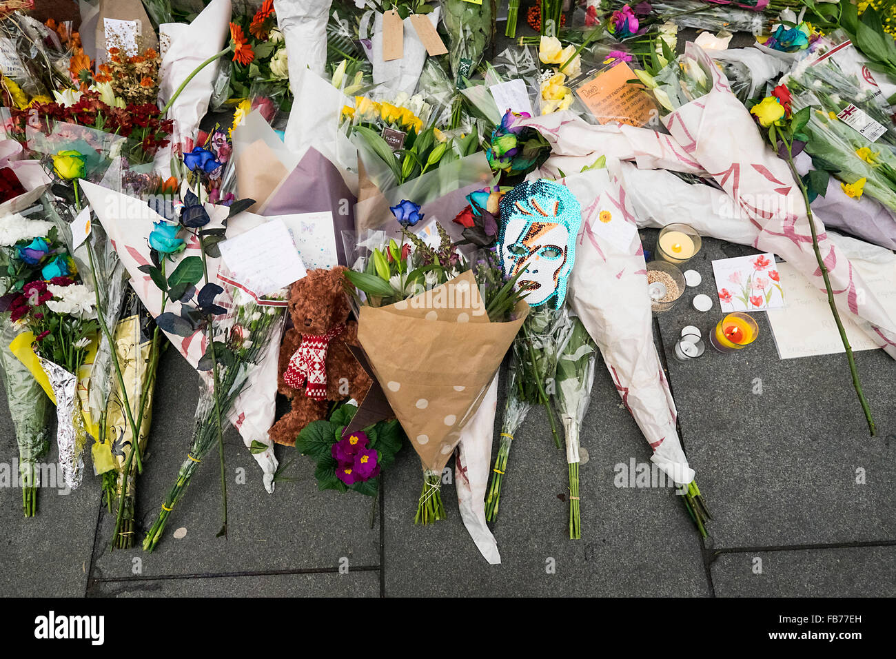 A mural of David Bowie with tributes and flowers - Stock Image