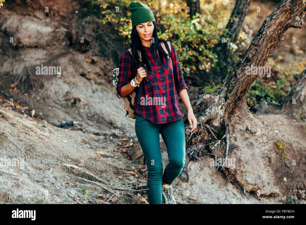 Woman in casuals hiking in forest - Stock Image