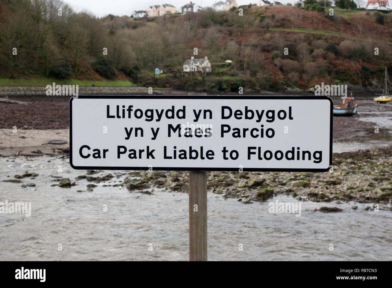 'Car Park Liable to Flooding' sign in Lower Town, Fishguard Stock Photo