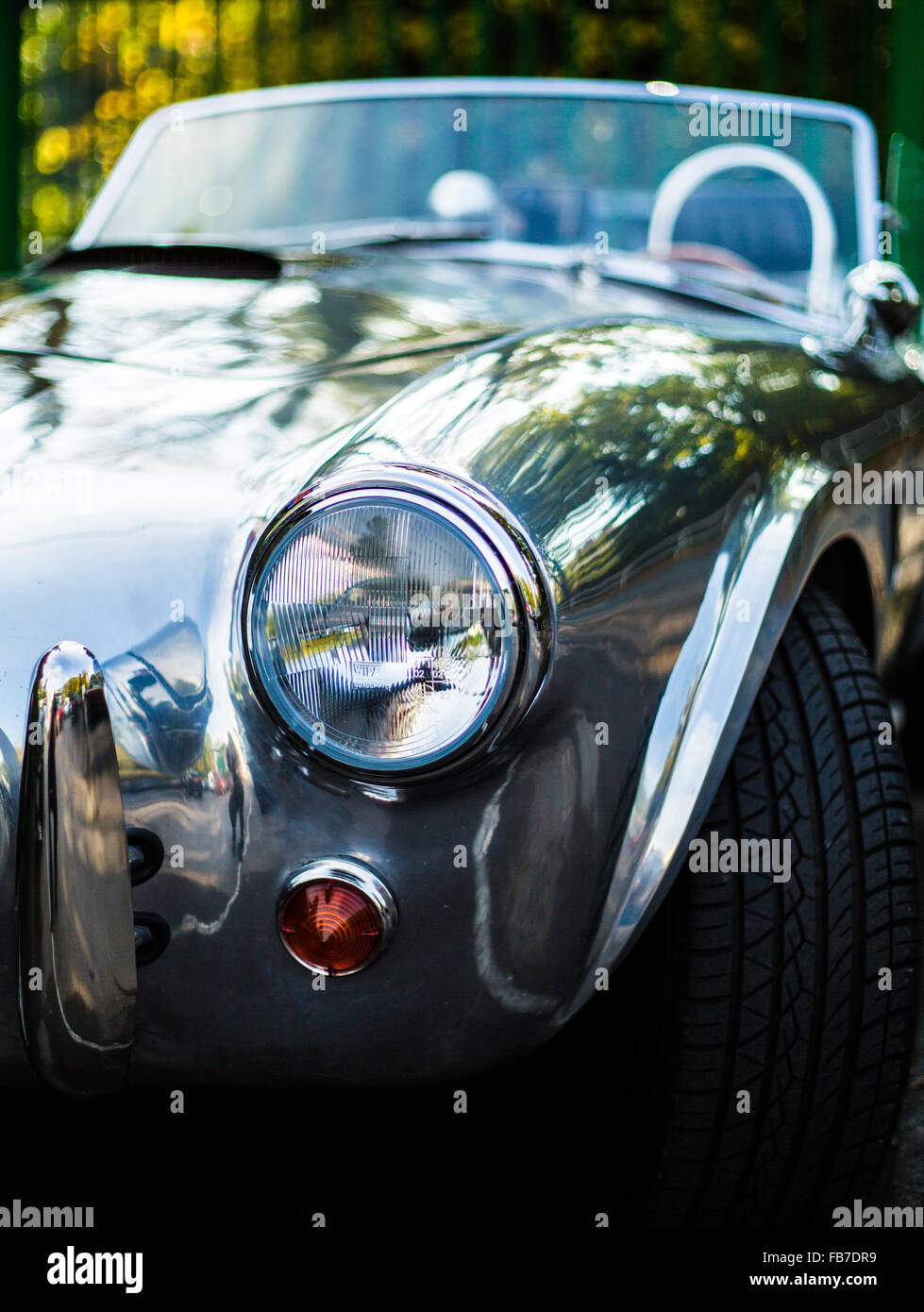 aluminum body convertible AC Cobra front drivers side view showing front wing and headlight - Stock Image