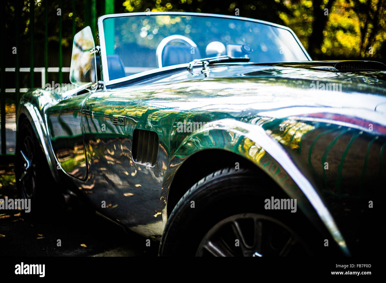 aluminum body convertible AC Cobra front passenger side view showing air intake vent - Stock Image