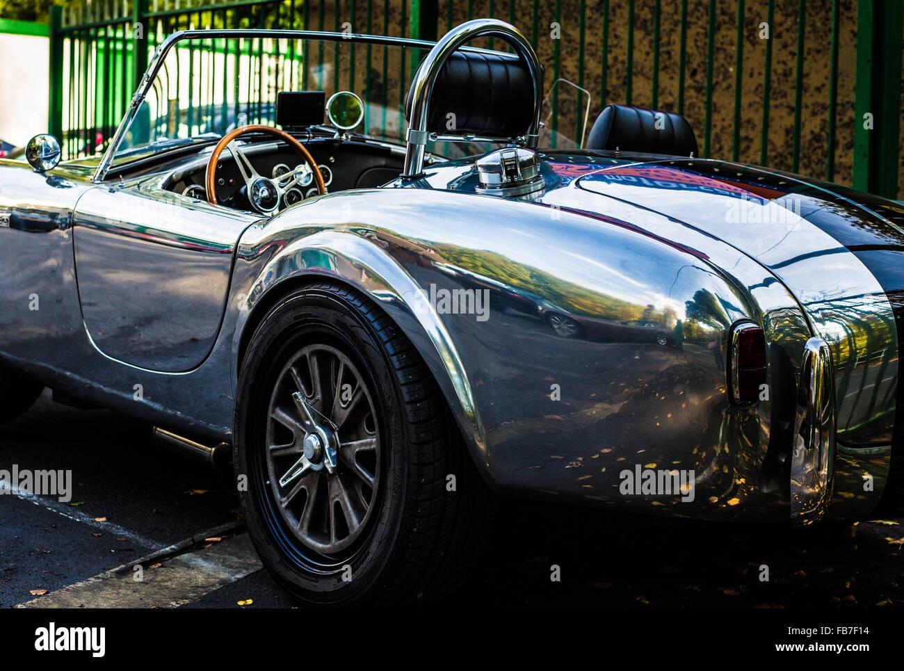 aluminum body convertible AC Cobra rear drivers side view - Stock Image