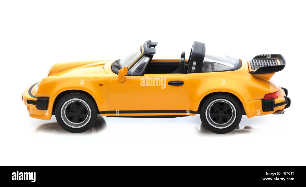 Old Scale Model  Porsche 911Targa Turbo on a white background - Stock Image