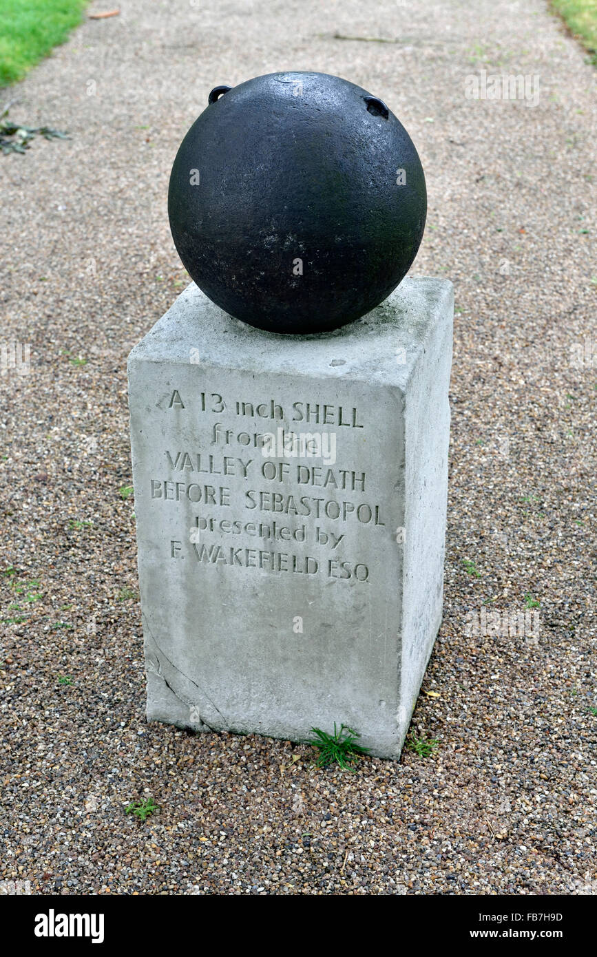 Shell on stone plinth from the Valley of Death Sebastopol, Edwardes Square Kensington and Chelsea, London England - Stock Image