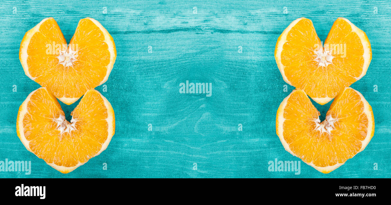 Background with heart shape orange slices, space for text. - Stock Image