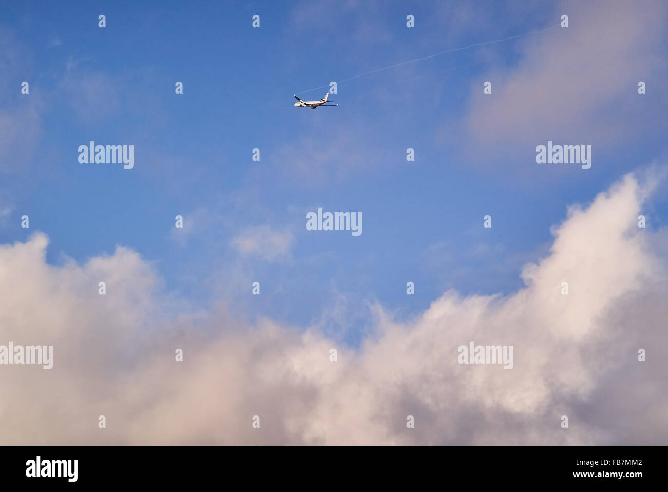 Ailriner flying through clouds - Stock Image