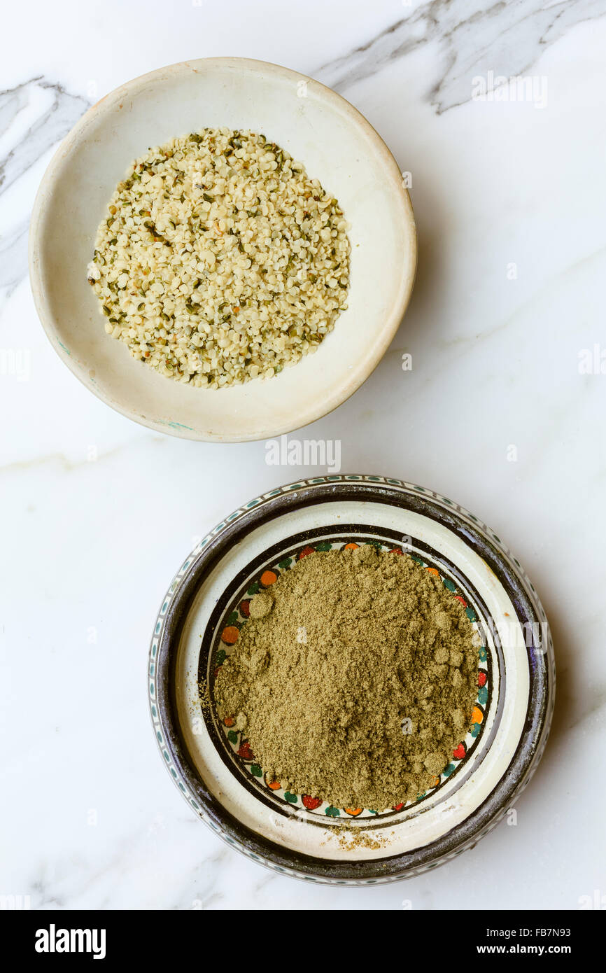 Bowls of protein-rich hemp seeds and powder - Stock Image