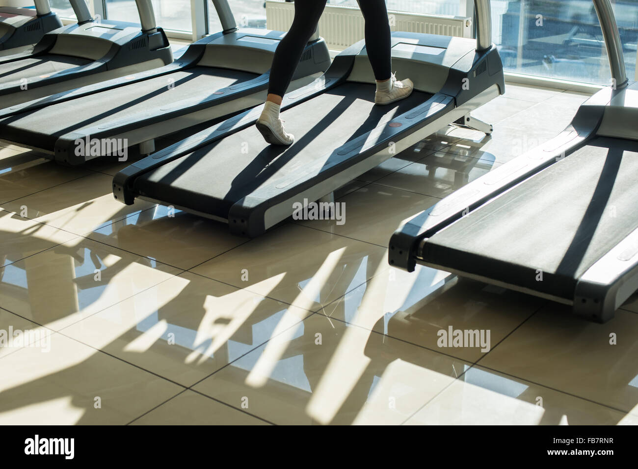 Treadmills in gym hall. - Stock Image