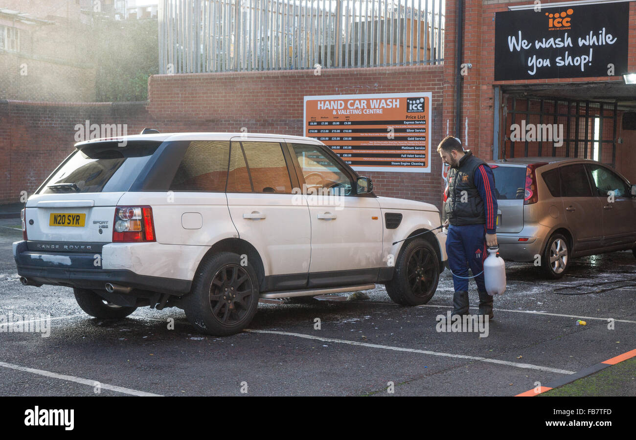 Car wash,  London.  Car being cleaned - Stock Image