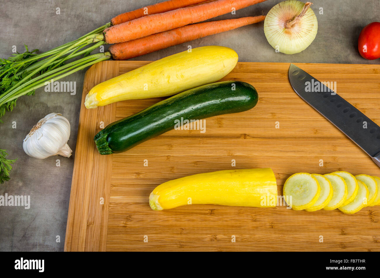 Wooden cutting board with vegetables - Stock Image