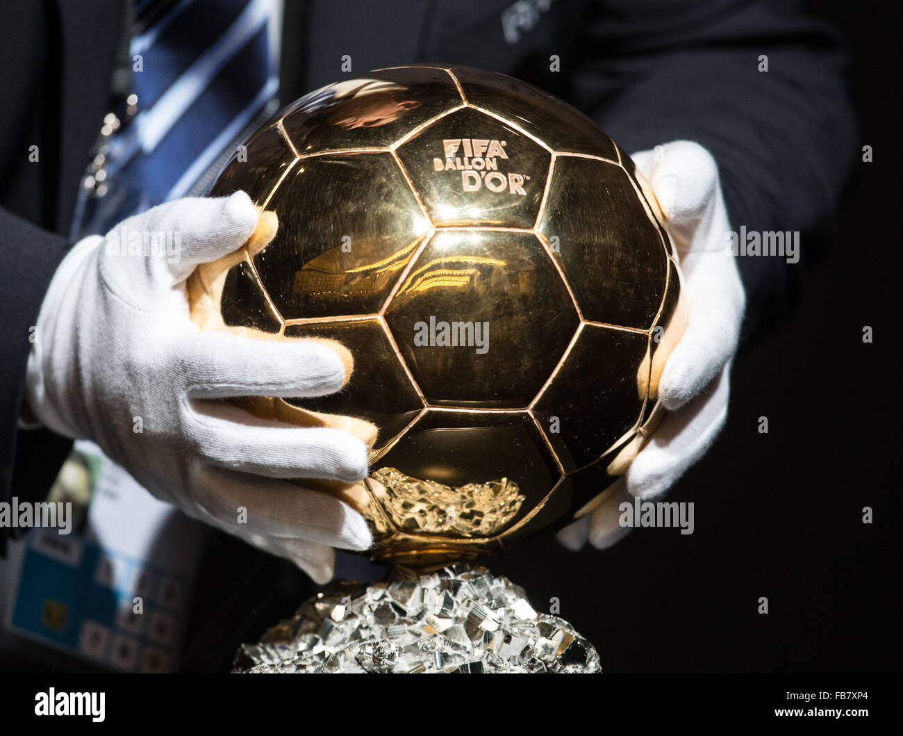 Zurich, Switzerland. 11th Jan, 2016. A man places the 2015 FIFA Ballon d'Or trophy ahead of the 2015 FIFA Ballon Stock Photo