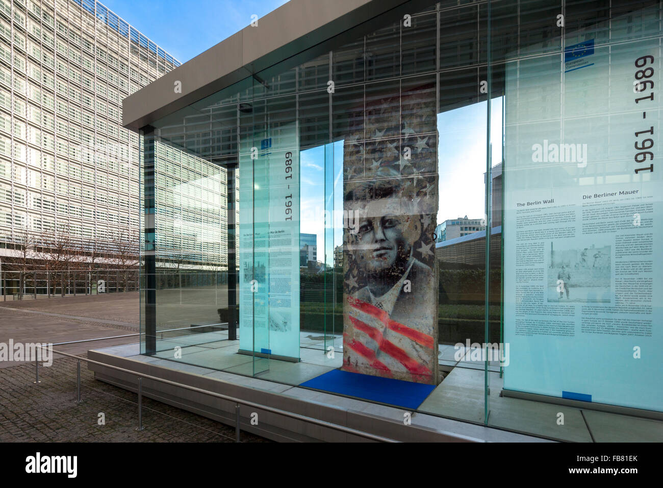 The Kennedy Piece part of the Berlin Wall in front of the Berlaymont Building of the EC, European Commission in - Stock Image