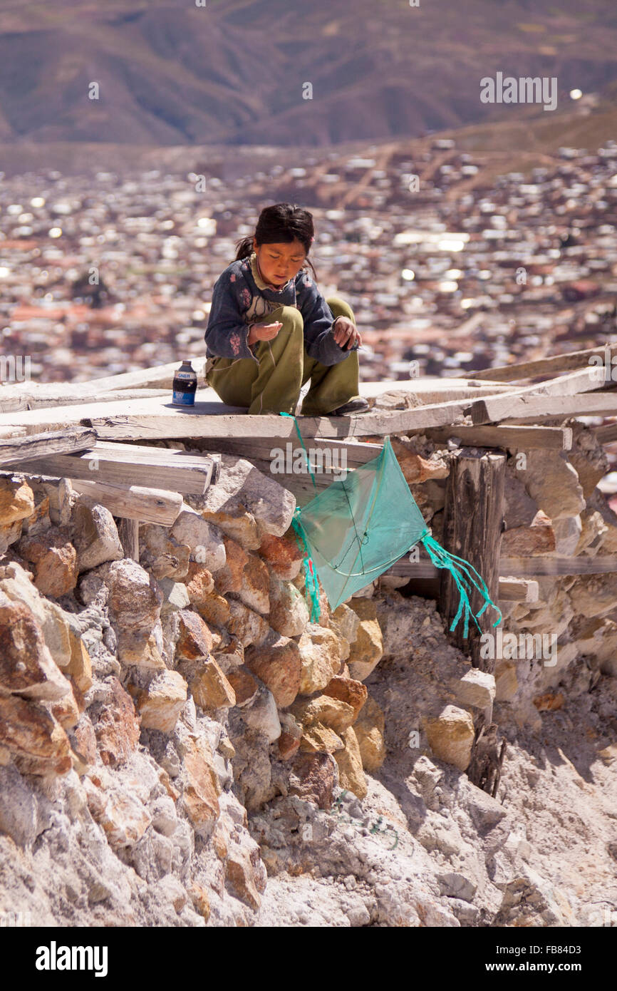 Young girl from a mining family on the slopes of Cerro Rico above Potosí, Bolivia. - Stock Image