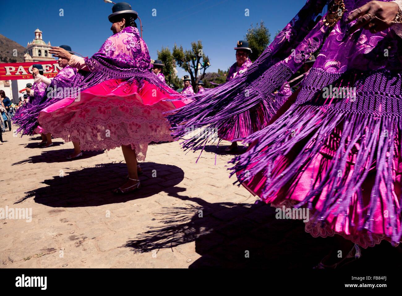 Dancing in the street during the Fiesta del Señor de la Cruz de Colquepata in Copacabana, Bolivia. - Stock Image