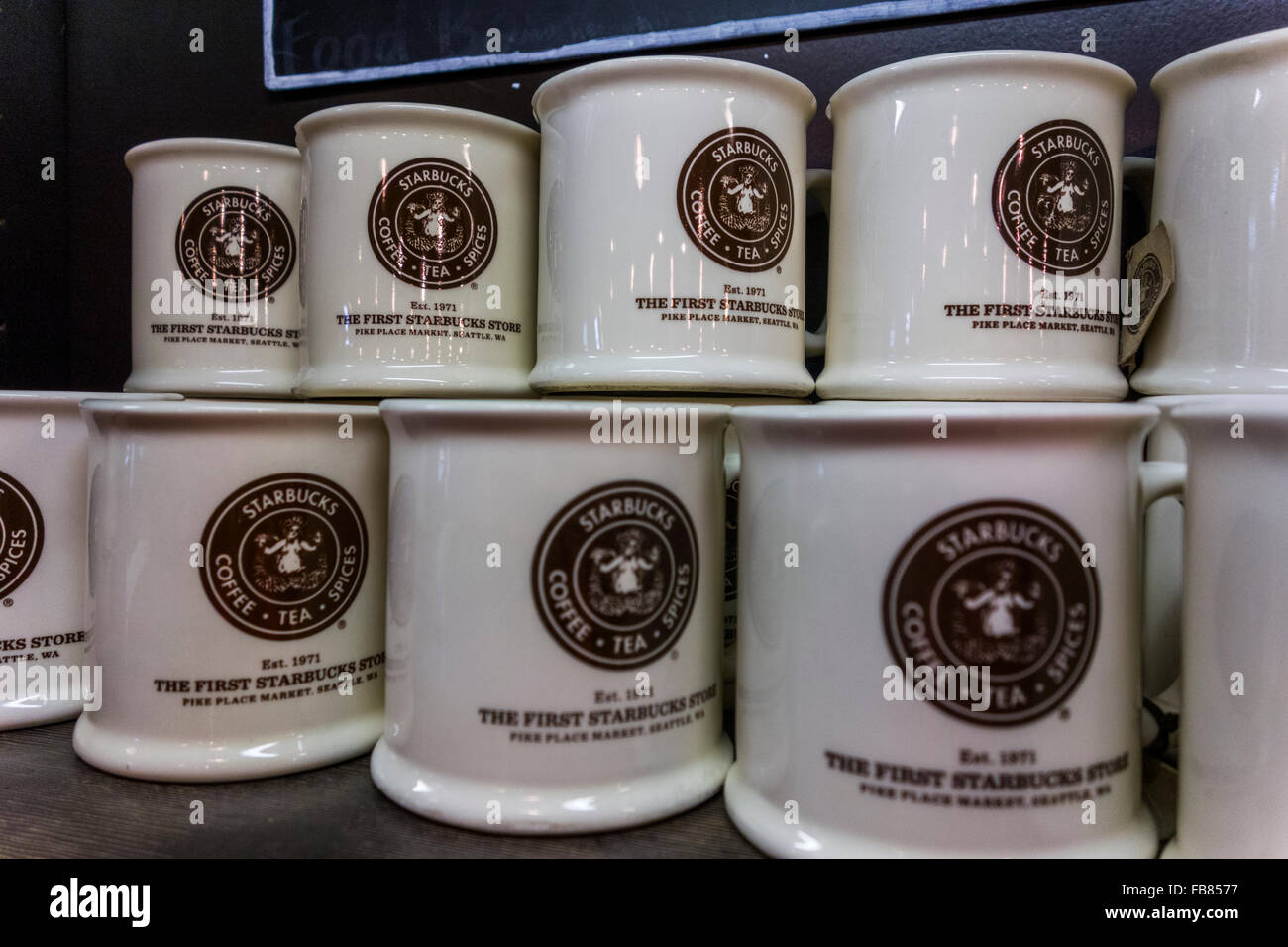 row of coffee mugs in original Starbucks store, Pike Place Market, Seattle, Washington State, USA - Stock Image