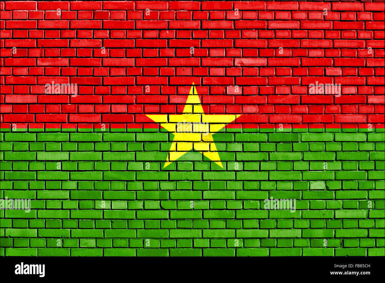 flag of Burkina Faso painted on brick wall - Stock Image