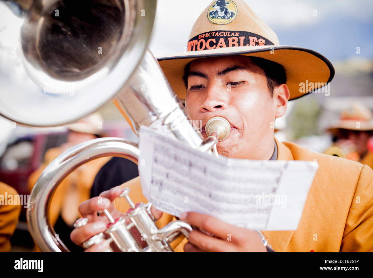 Musician on parade during a fiesta in San Pedro, La Paz province, Bolivia. - Stock Image
