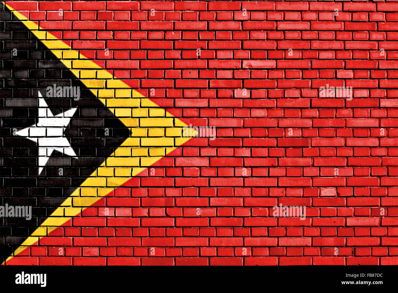 flag of East Timor painted on brick wall - Stock Image