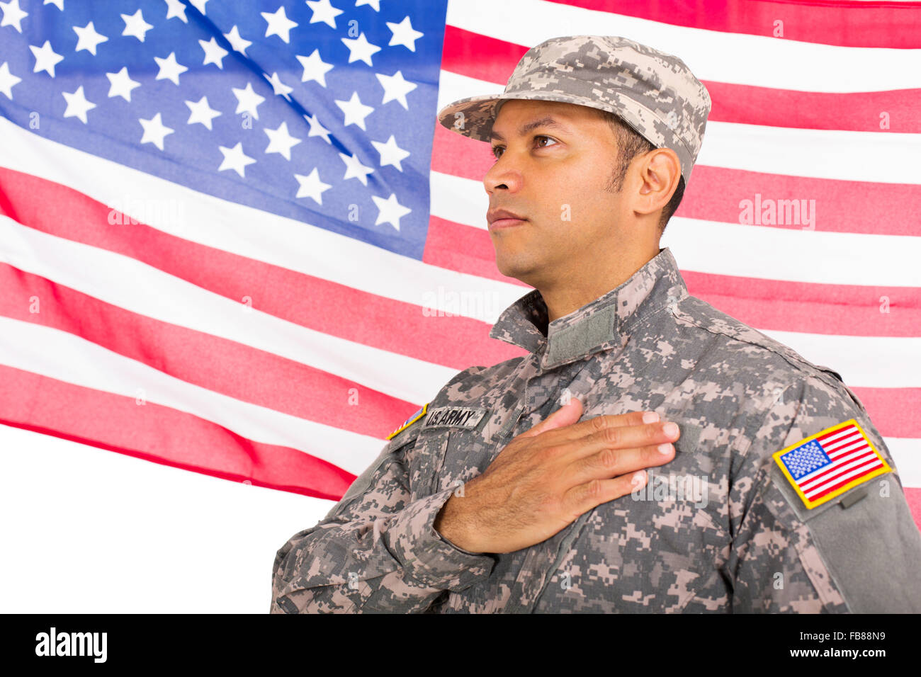 handsome American patriotic soldier with usa flag on background - Stock Image