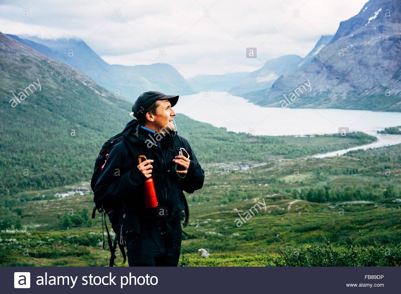 Sweden, Lapland, Kaitumjaure, Kungsleden, Male hiker in mountain valley - Stock Image