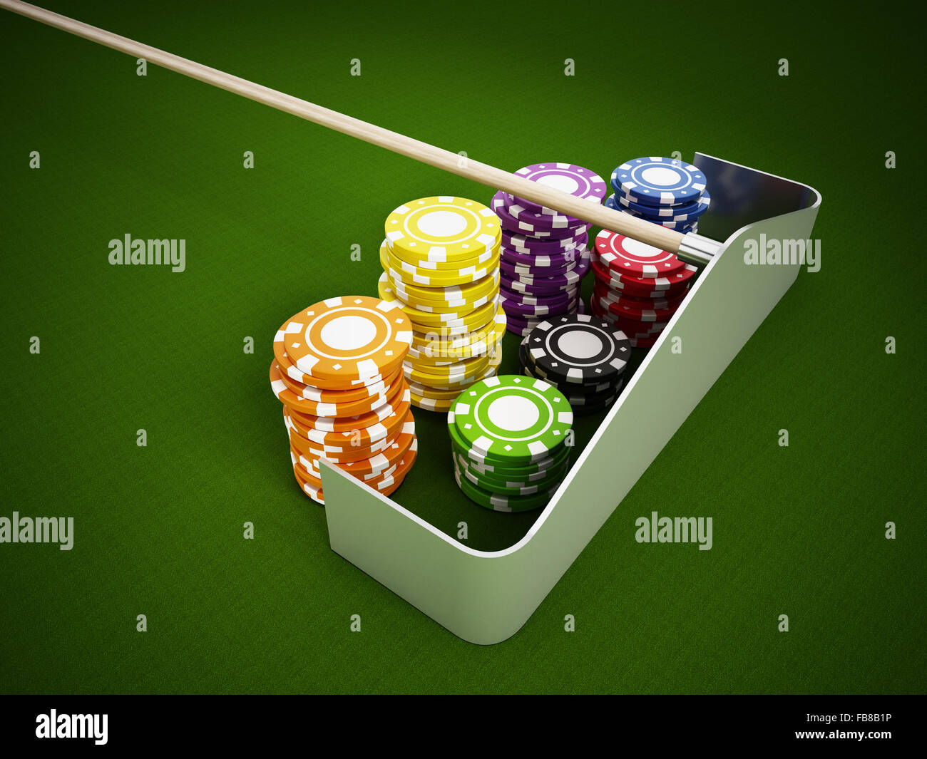 Casino chips standing on green cloth. - Stock Image