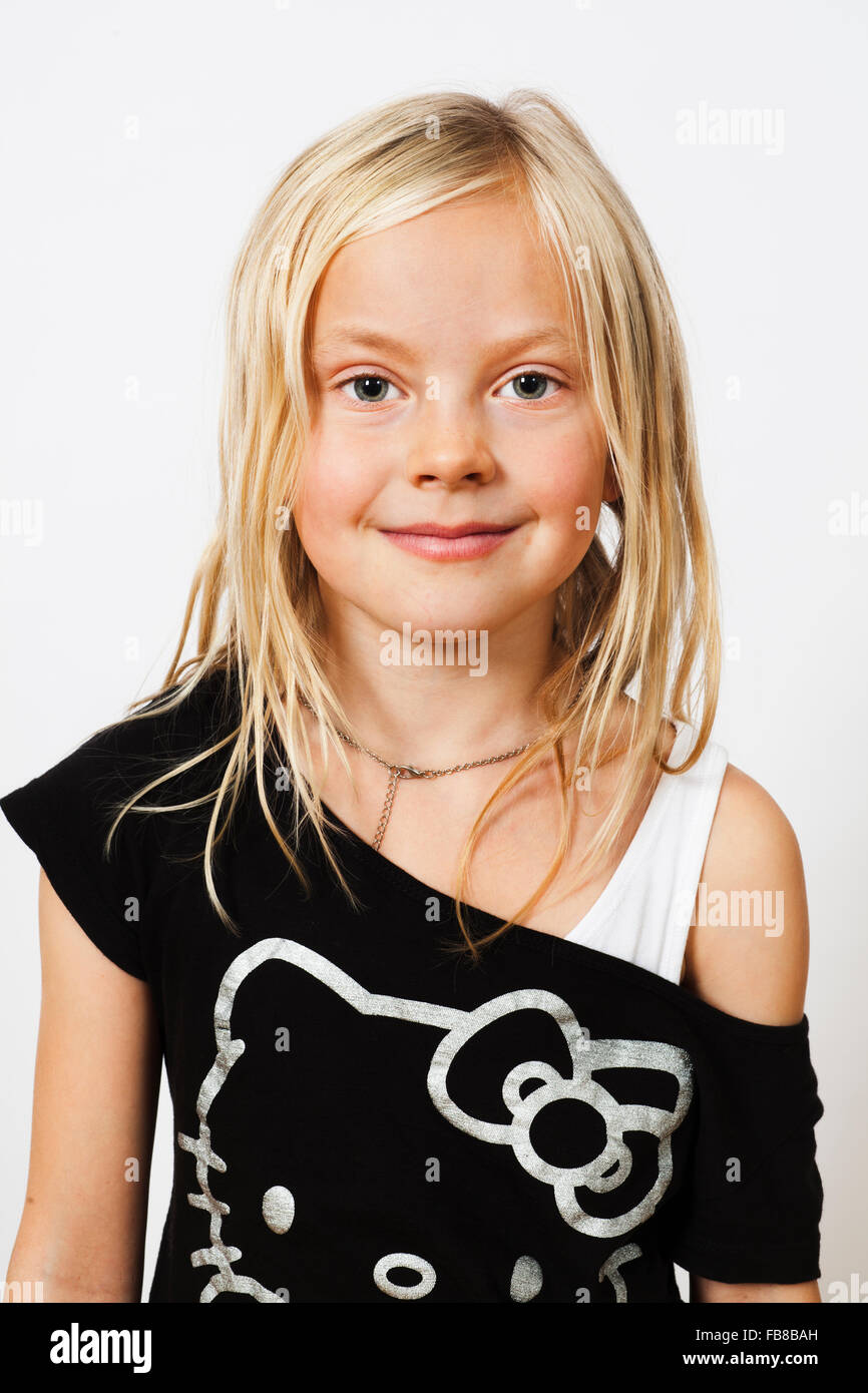 Portrait of smiling blonde girl (6-7) - Stock Image