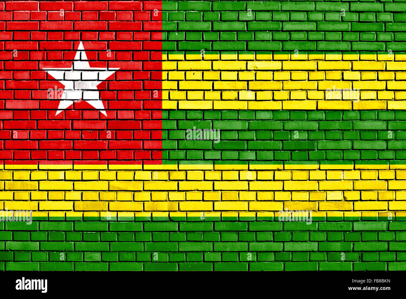 flag of Togo painted on brick wall - Stock Image