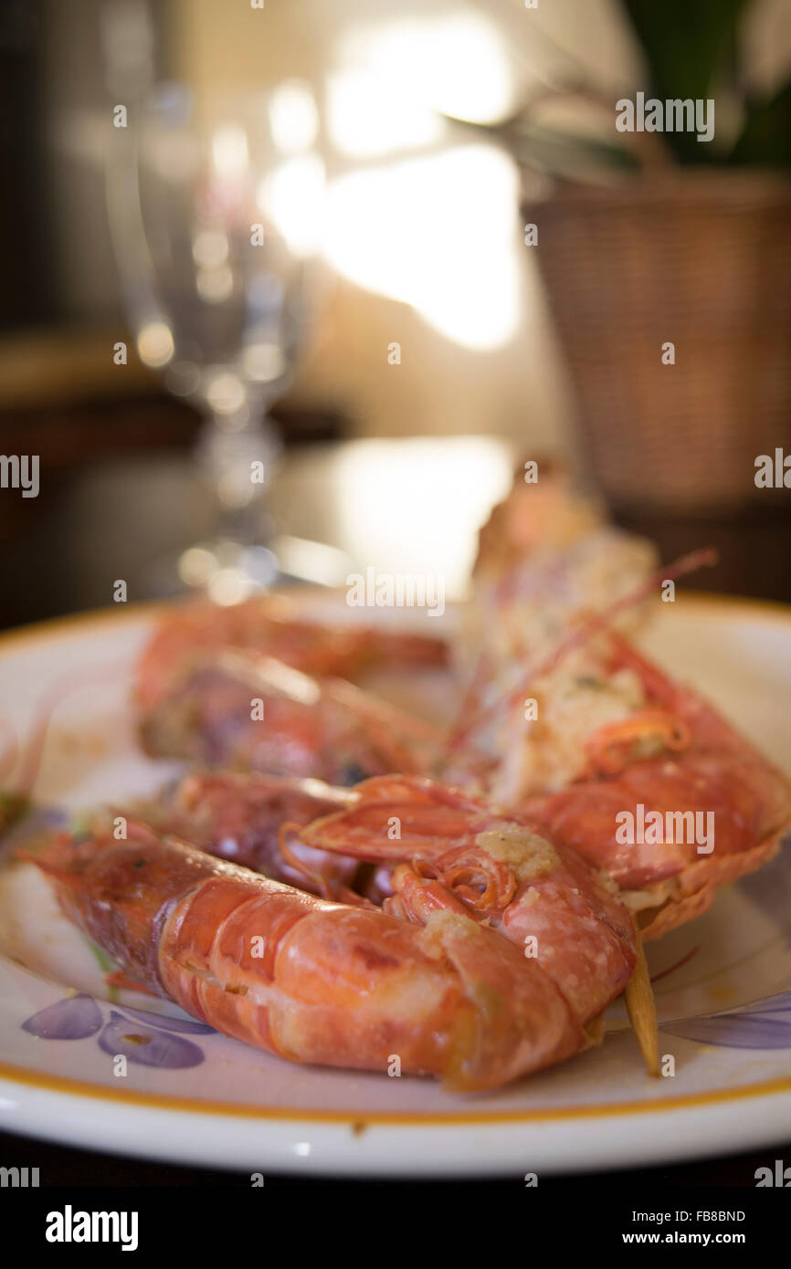 breaded and fried skewers of fish with near some jumbo prawns Stock Photo