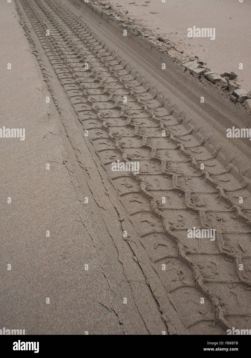 Netherlands, Zandvoort, Tire tracks in sand - Stock Image