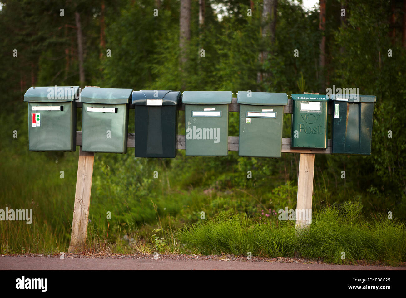 Sweden, Dalarna, Solleron, Row of mailboxes Stock Photo