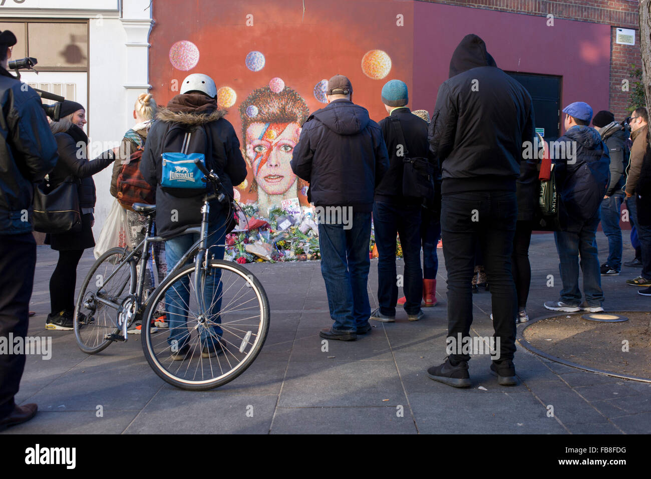 London 12th January 2016: Fans of iconic English music artist David Bowie who died from Cancer at the age of 69 Stock Photo