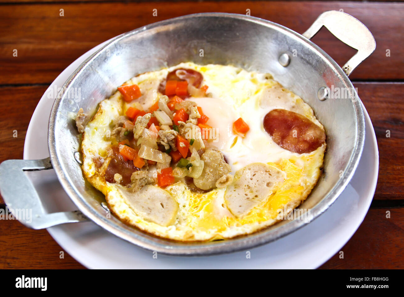 Indochina pan-fried egg with toppings in my homemade Thai style,Vietnamese Omelette,egg pan.Pan omelette. - Stock Image