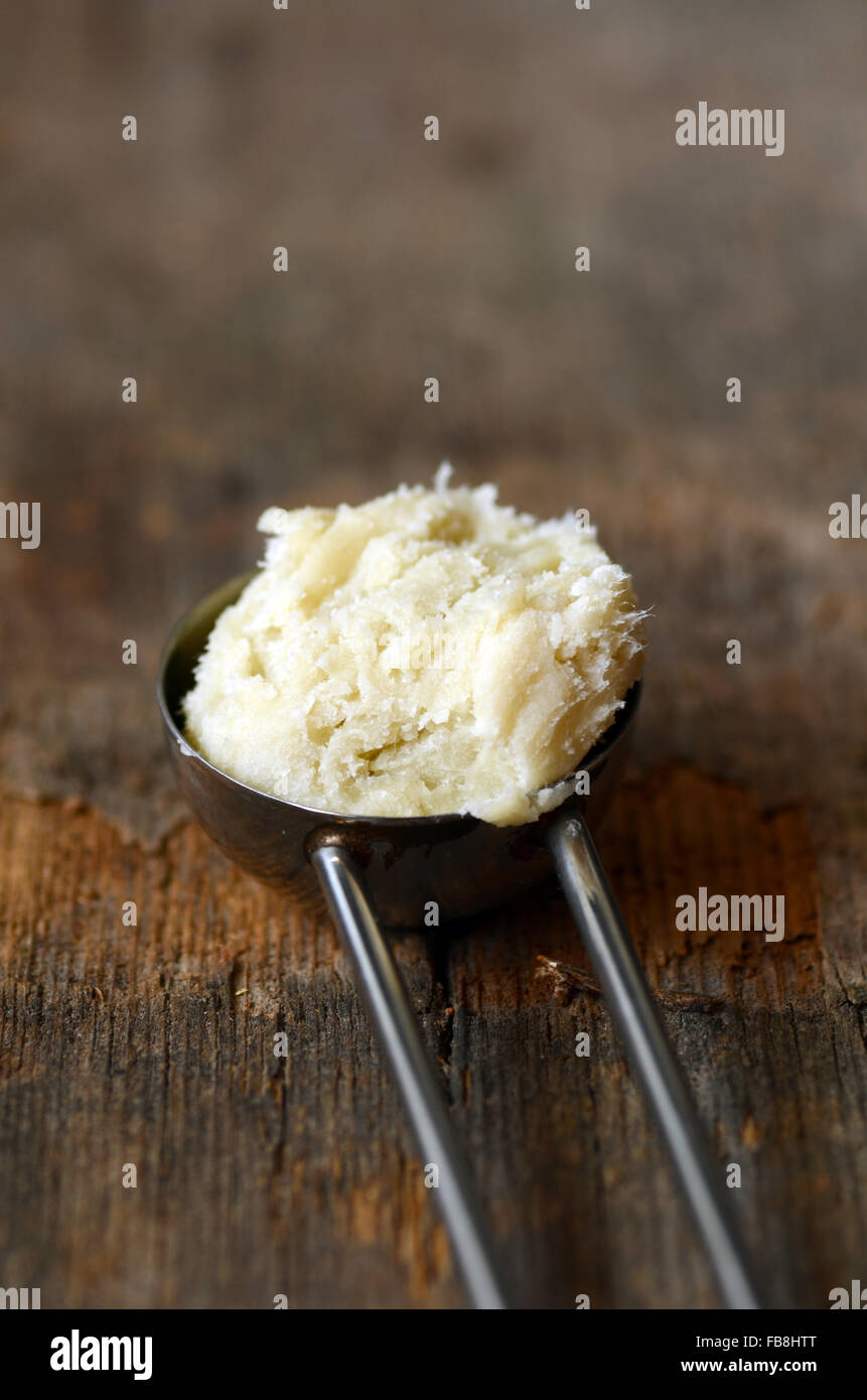 Unrefined raw shea butter on wooden background Stock Photo