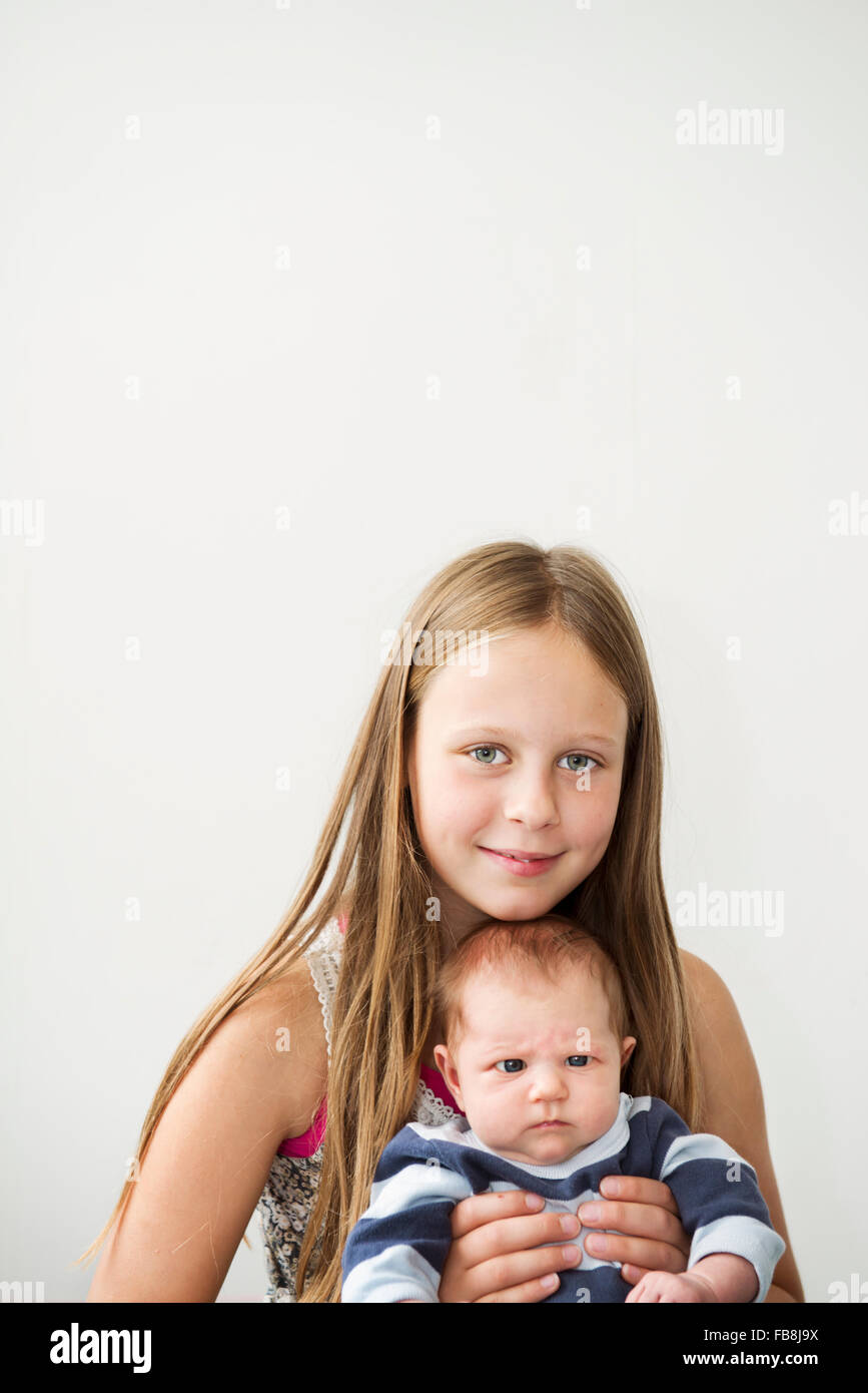 Sweden, Portrait of girl with newborn sister (0-1 months) - Stock Image