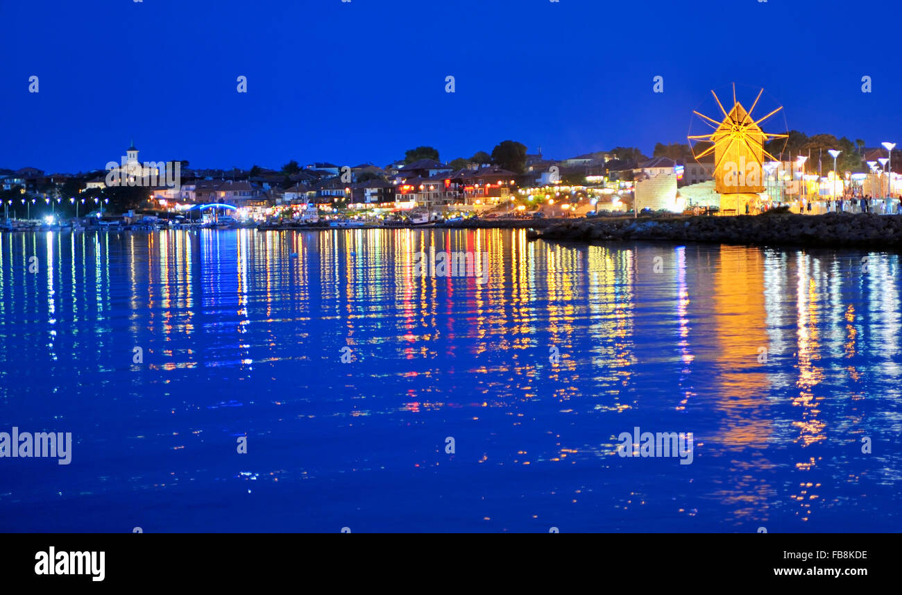 Wooden windmill in Nessebar at night - Stock Image