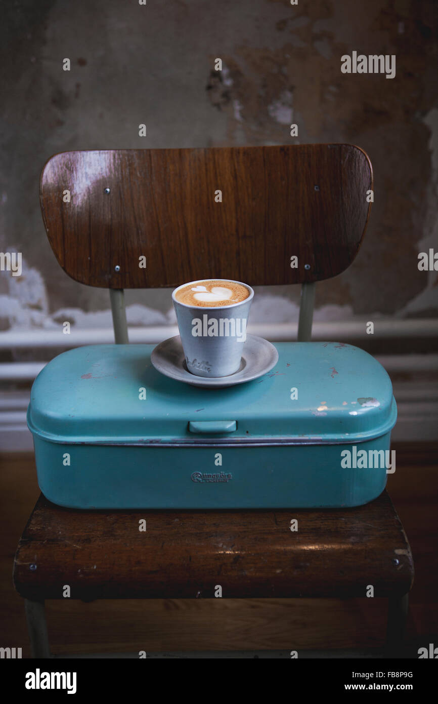 Latte coffee on metal container - Stock Image
