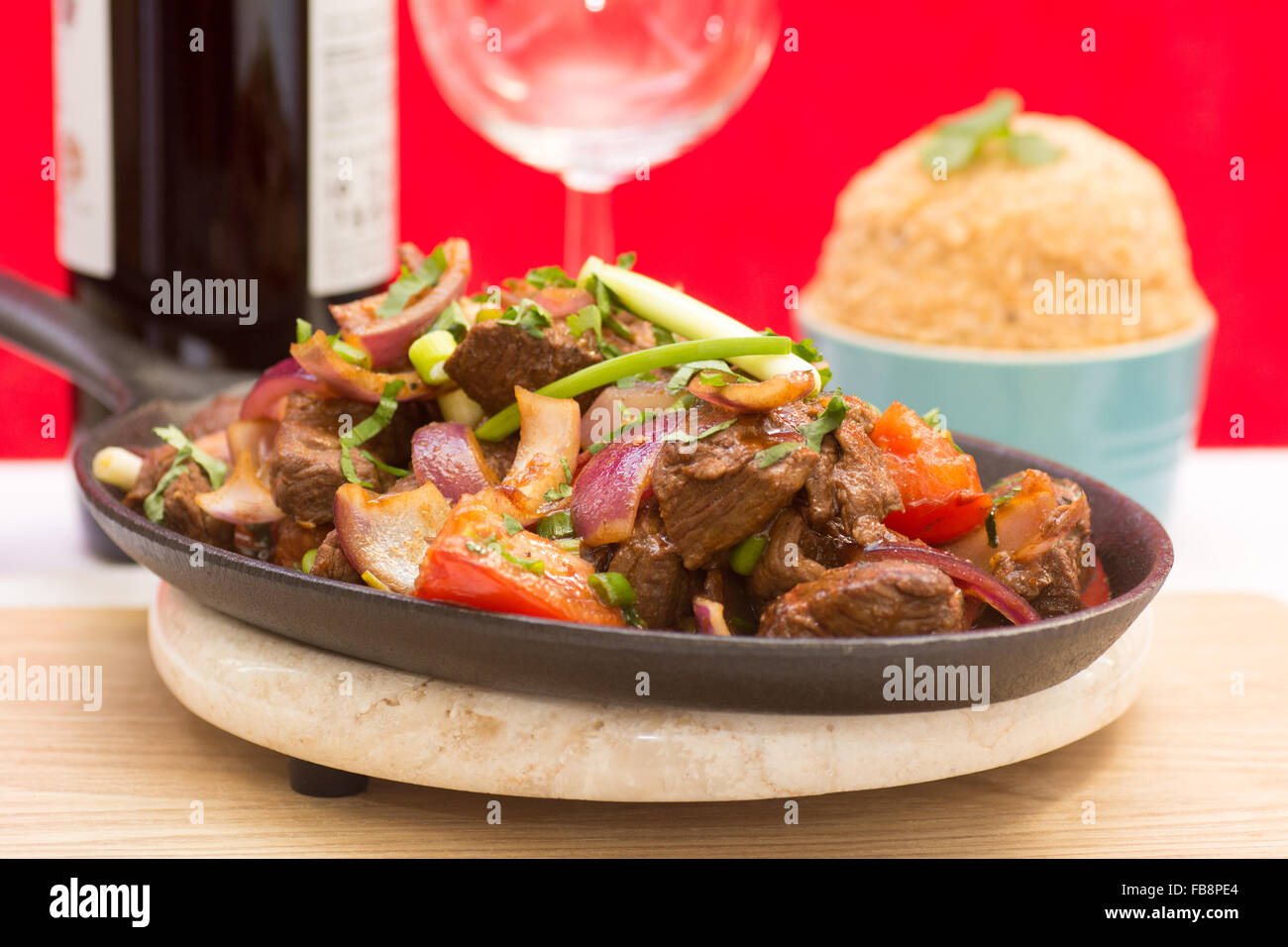Lomo Saltado - a very popular dish in Peru of stir-fried beef with a side dish of Tacu Taco rice Stock Photo