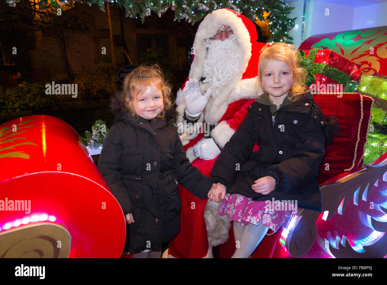 Girls girl sisters meet santa claus father christmas on his girls girl sisters meet santa claus father christmas on his sleigh organised by the rotary club in great britain m4hsunfo