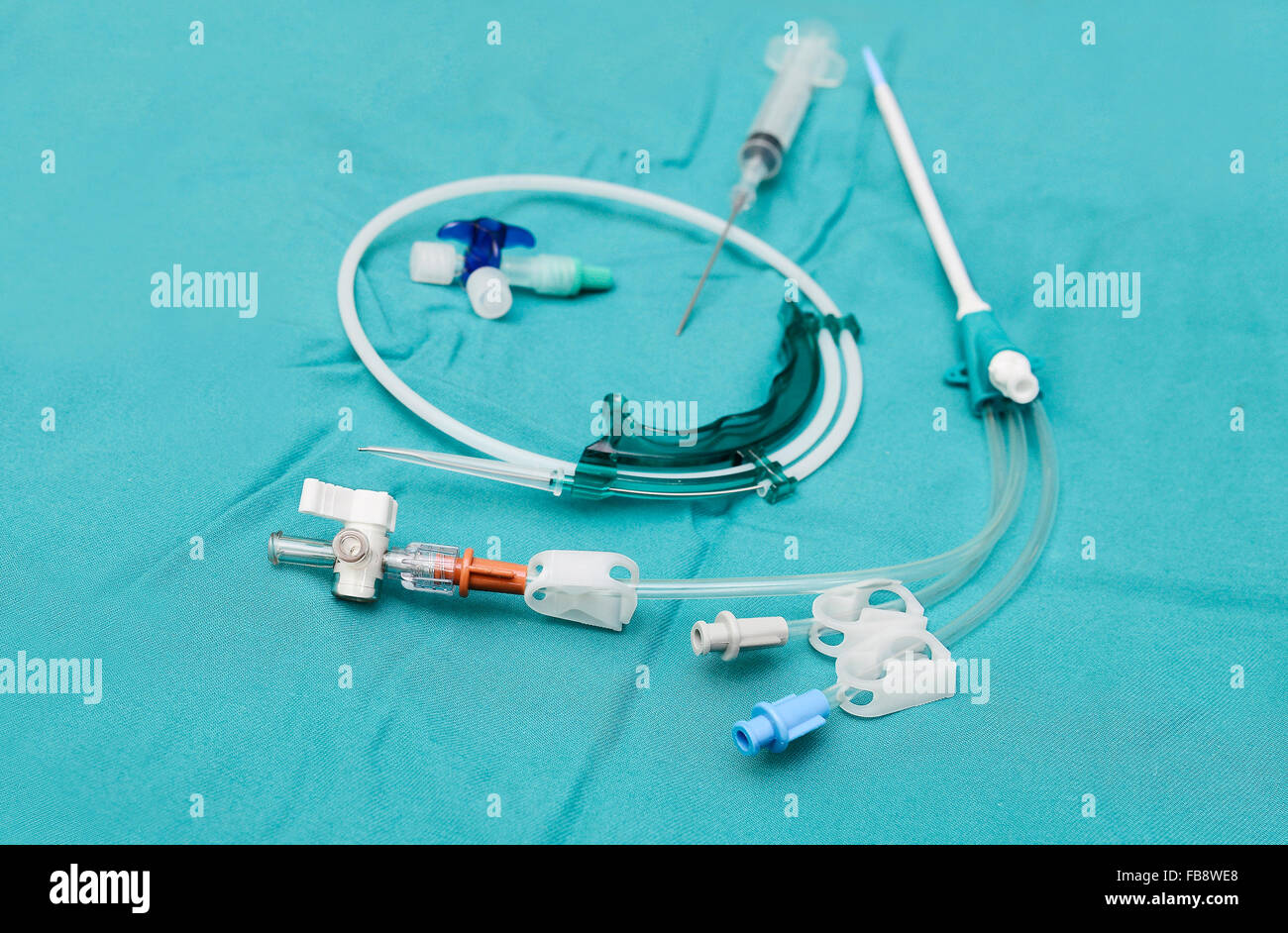 Central venous catheter with guide wire,plastic sheat, needle and syringe - Stock Image