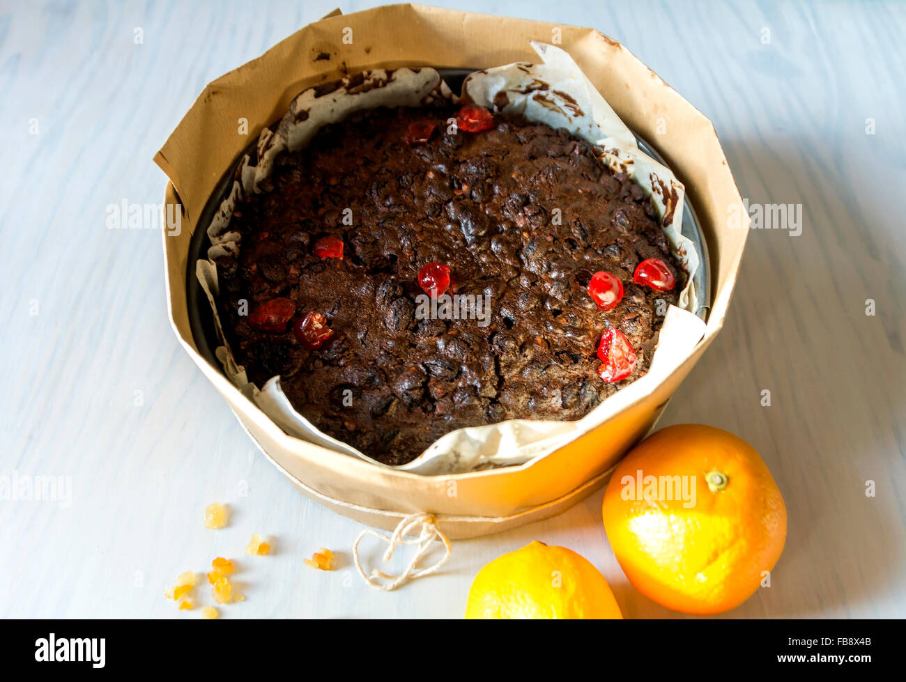 Christmas cake has to be baked for hours so it is wrapped in brown paper to protect from burning. - Stock Image