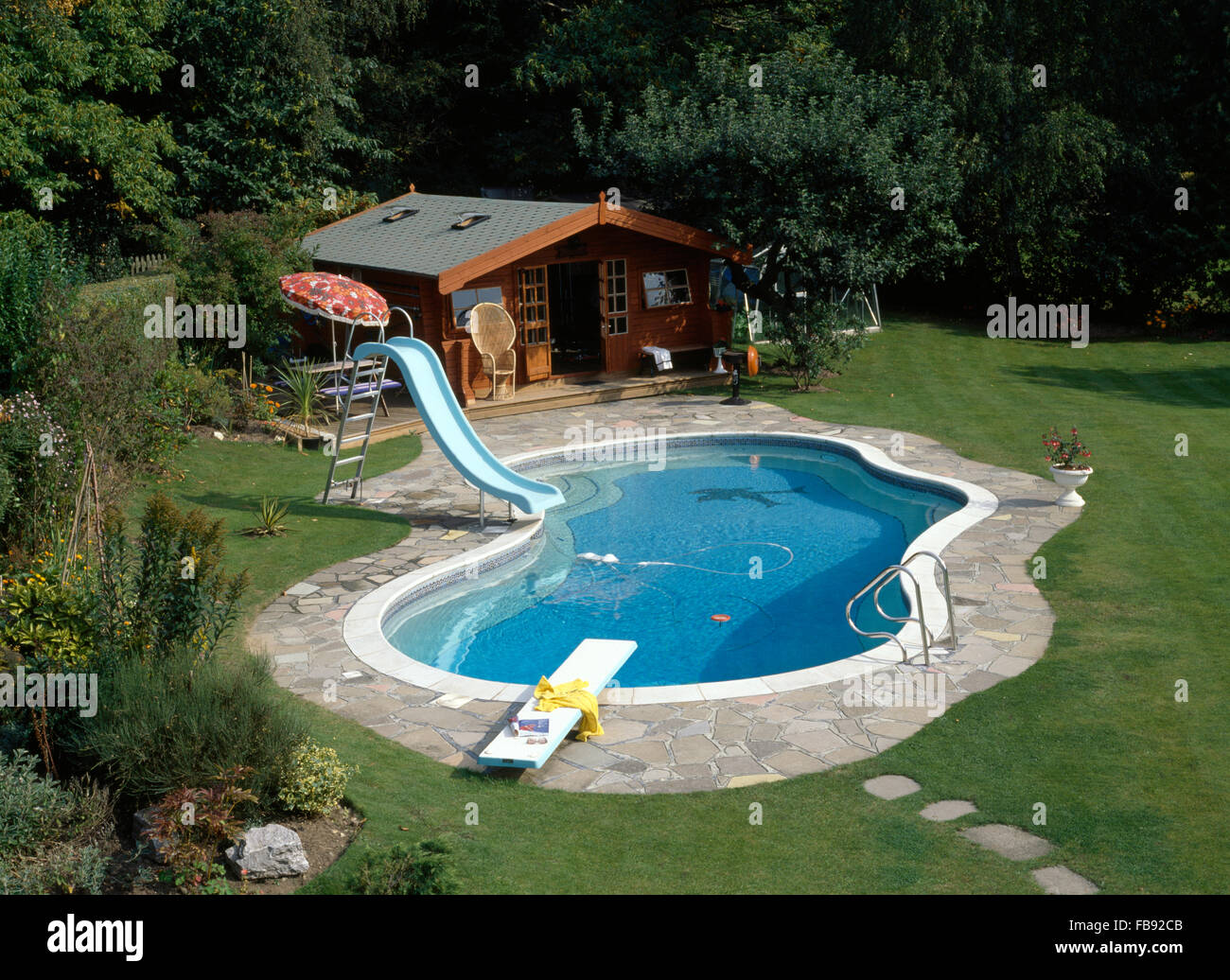 Birds Eye View Of A Kidney Shaped Swimming Pool With A Slide In Country  Garden With A Large Summerhouse