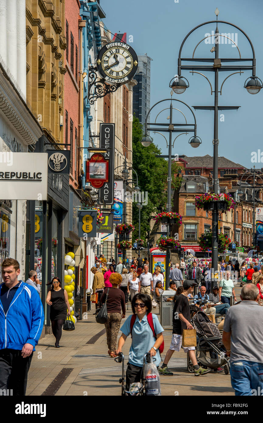 Shoppers in a busy Leeds city centre on a summers day. - Stock Image