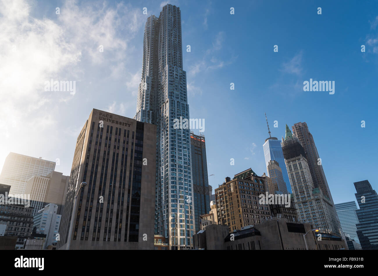 View of Pace University alongside New York by Gehry, one of the tallest residential apartment buildings in the world. - Stock Image