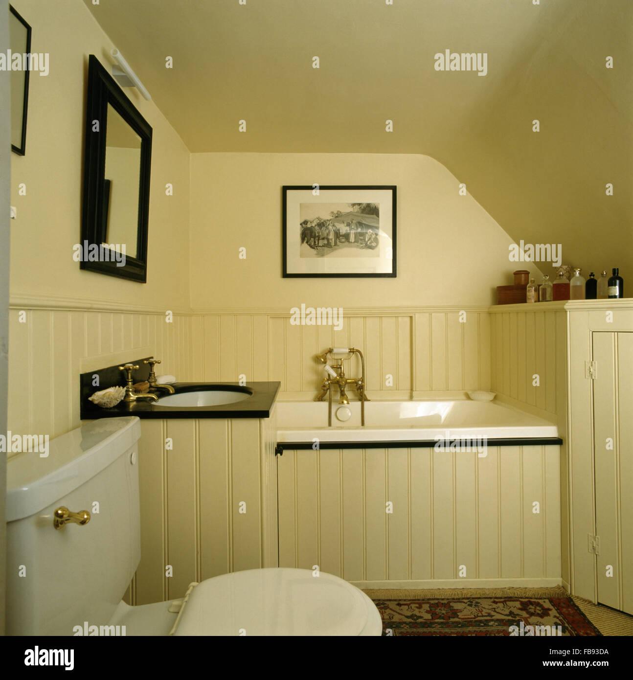 Small cream, tongue+groove paneled bathroom Stock Photo - Alamy