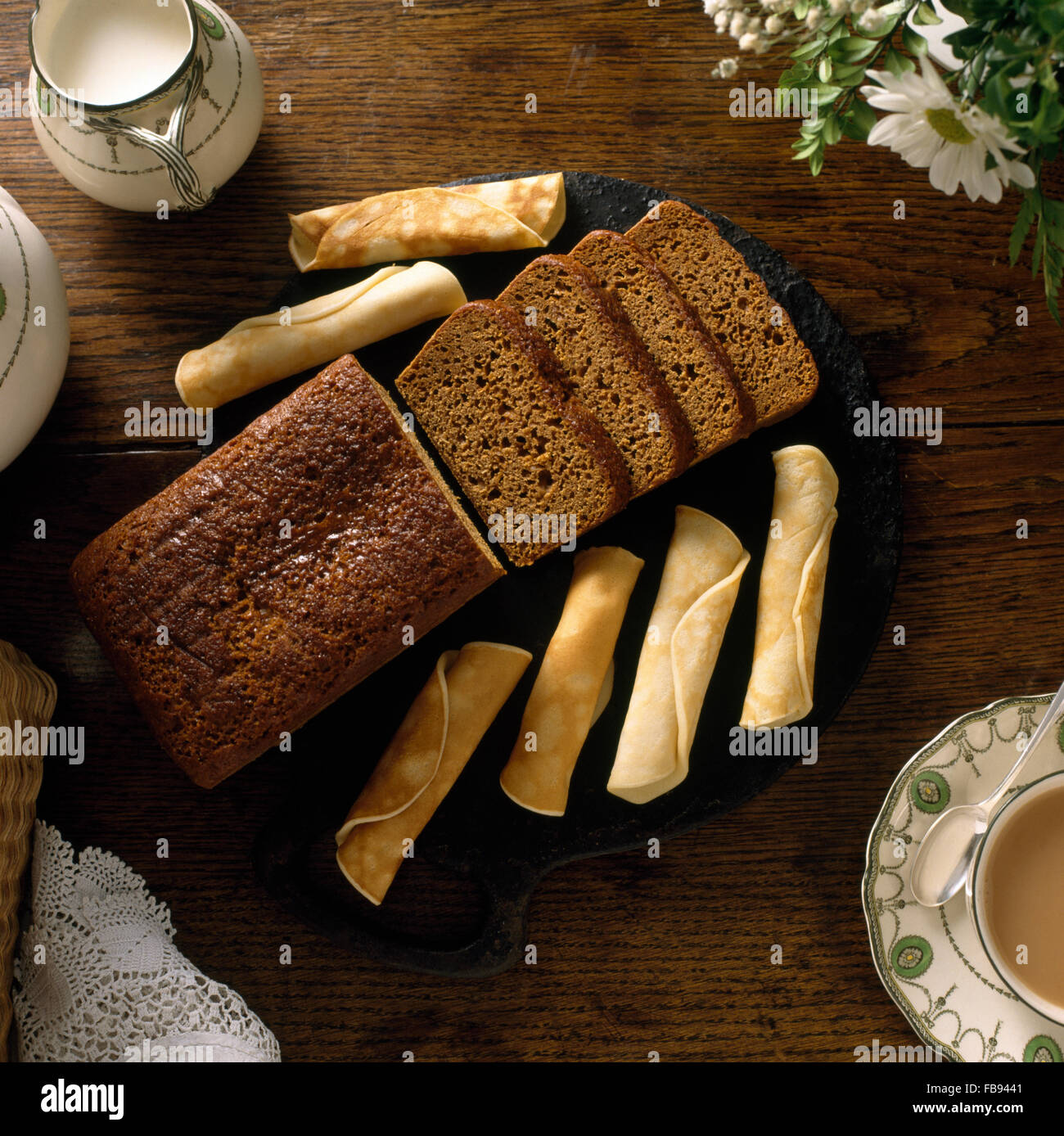 Close-up of home made ginger cake and pancakes - Stock Image